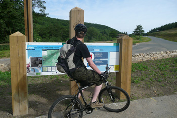 Cyclist at Entrance to Dalby Forest - Wayside Park & Lakes